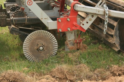 Keyline plough with soil biofertilizer lines