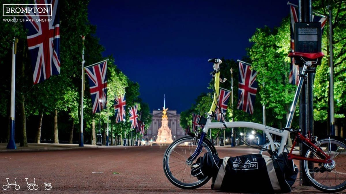 A famous Brompton Bike positioned in front of Buckingham Palace