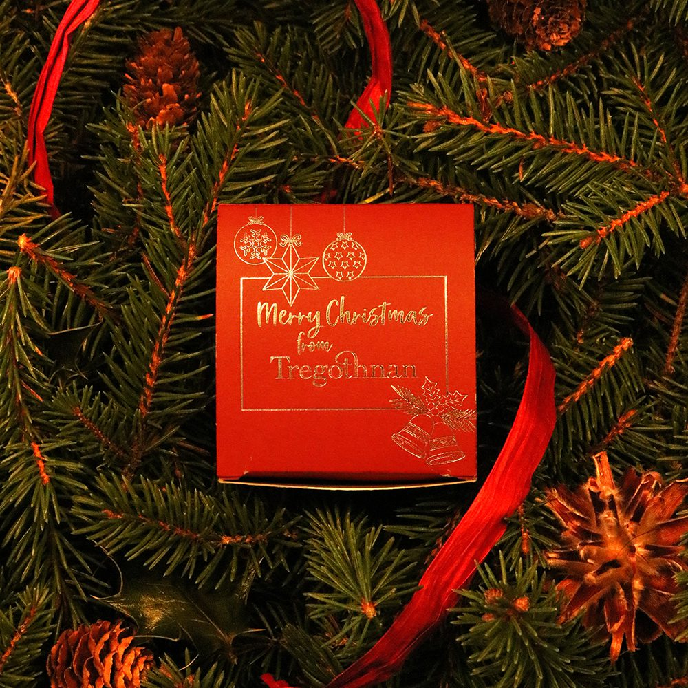 stocking filler box on a bed of Christmas tree branches