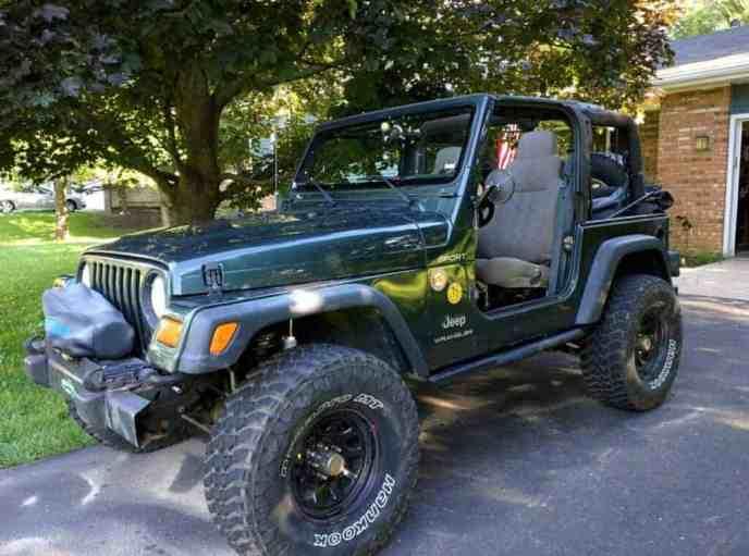 Jeep Wrangler TJ in driveway