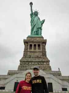 couple in front of Statue of Liberty