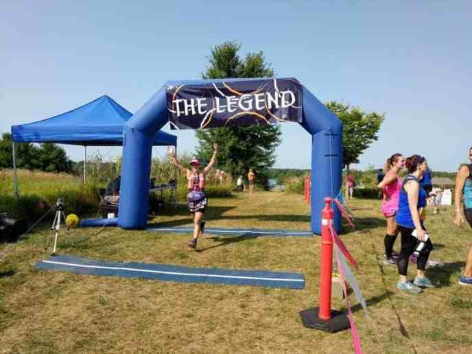 Female runner crossing finish line