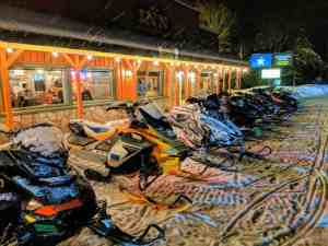 snowmobiles in front of restaurant