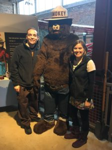man and woman with Smokey Bear (costume)