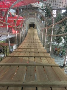 Suspension bridge inside Outdoor Adventure Center state park