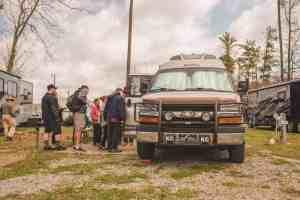 people standing outside a Class B RV van