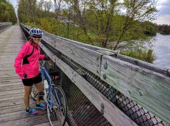 female cyclist on bridge on White Pine Trail State Park