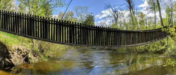 Suspension bridge over a river in Rifle River State Recreation Area