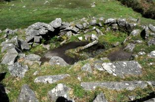 The fulact fiadh, with water-filled trough and hearth