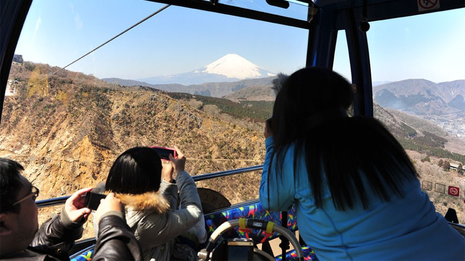 Taking a picture of Mt Fuji from a cable car