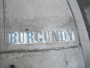 At intersections in the French Quarter, on the side walks will be these street tiles. Burgundy is a street parellel to Rampart