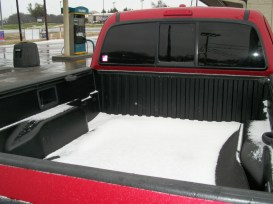 The snow in the bed of Steve's truck.