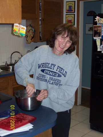 Me wearing a hand me down sweatshirt from the 2003 trip Do not let the date on this picture deceive you. It was taken at Christmas 2011. Not sure what I am cooking in this picture maybe chocolate chip cookies.