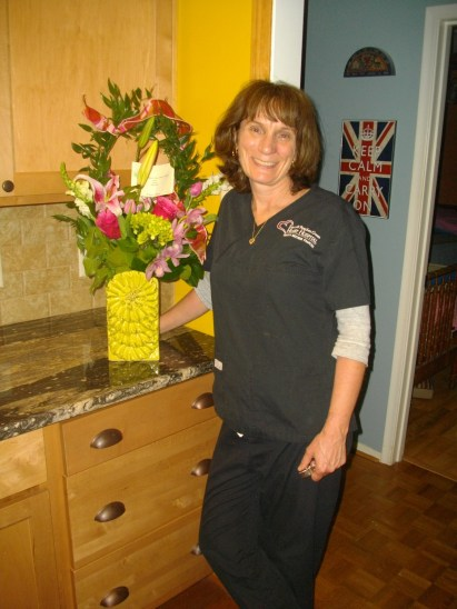 Hannah sent me these for Mother Day to work. Steve took this picture last night after I got home. These are my work scrubs with the logo for the heart hospital on the right side.