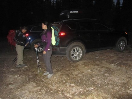 Putting packs on at 5:30 am at the trailhead.