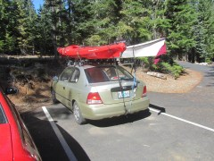 Little car loaded with big kayaks.