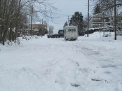 Two trucks that could not make it up the icy hill.