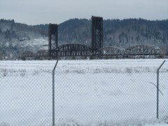 Looking over the super fund site to the Rail Road Bridge and Forest Park beyond.