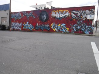By Kango, Joins, giver and other artist. SE 2nd and Stark on the Alexis warehouse.