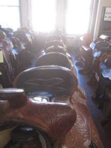 Row after row of new and used saddles. If you have only seen these in movies this is a place to feel the real leather.