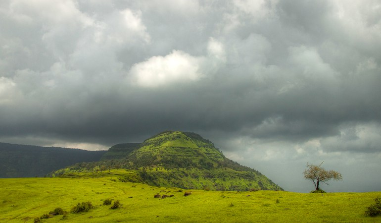 Storm clouds gather over Garbett Plateau
