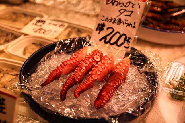 The octopus arms on stick look delicious. You can find this and many more snacks in Nishiki