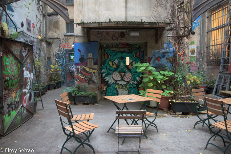 Art adorns the wall around this open air cafe