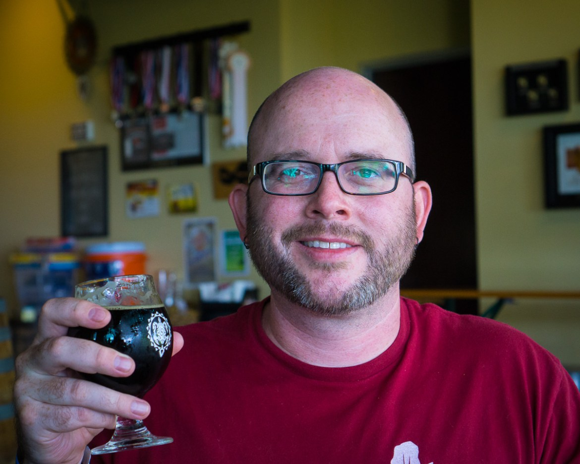 Rich drinking Imperial Toasted Coconut Porter at Maui Brewing