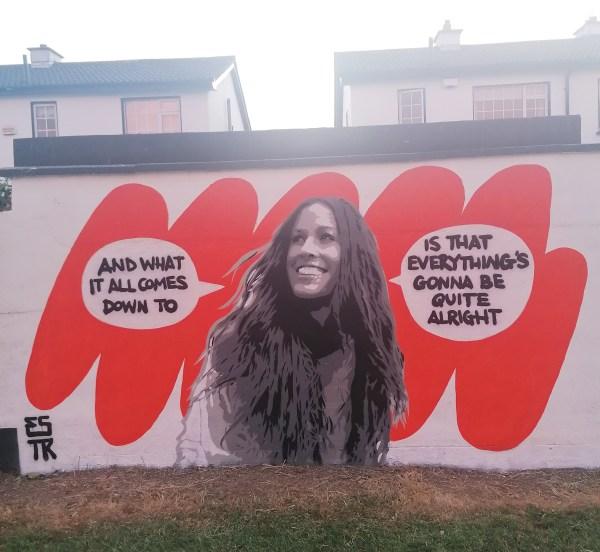 Emma Blake street art mural on a housing estate wall