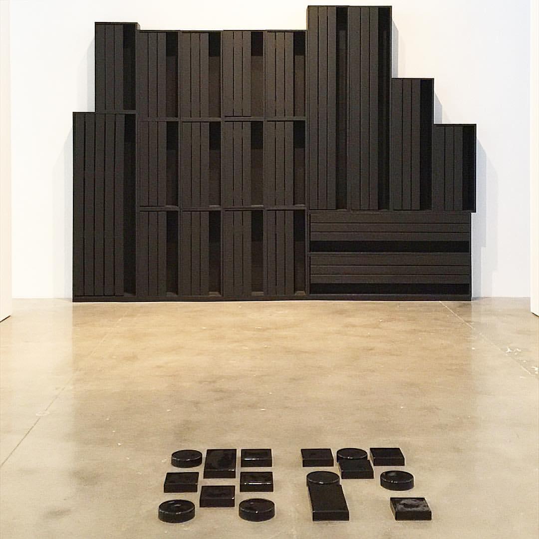 Louise Nevelson, City-Reflection, 1972, wood painted black; Adam Pendleton, Untitled (code poem), ceramic, 2016