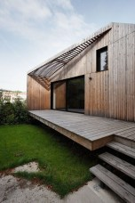 A Wooden House That's Simple On The Outside But Modern On The Inside 03