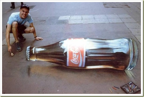 Huge Coca Cola bottle simply lying on the street