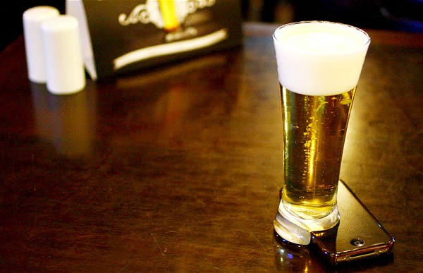 The Beer Glass That Only Stands Up When Your Cell Phone is Attached to the Bottom