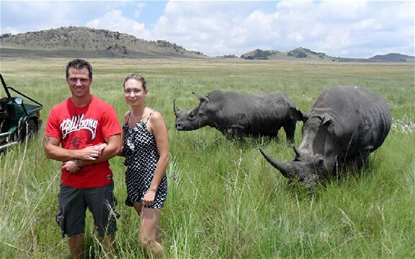 The woman who had a terrible posing in front of rhinos