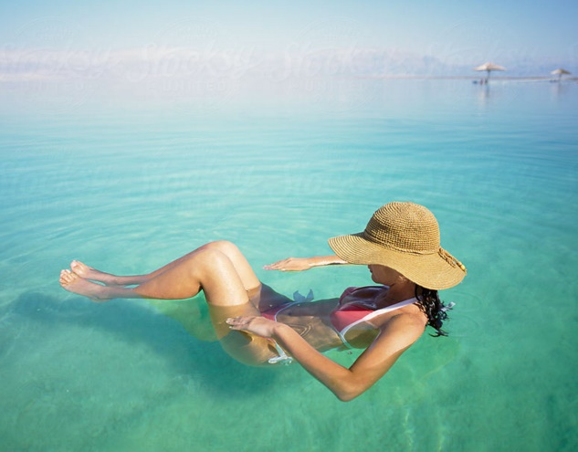 Women floating in Dead sea water