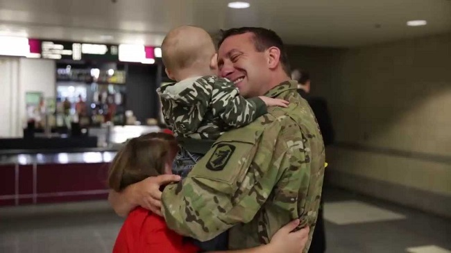 A soldier with his kids