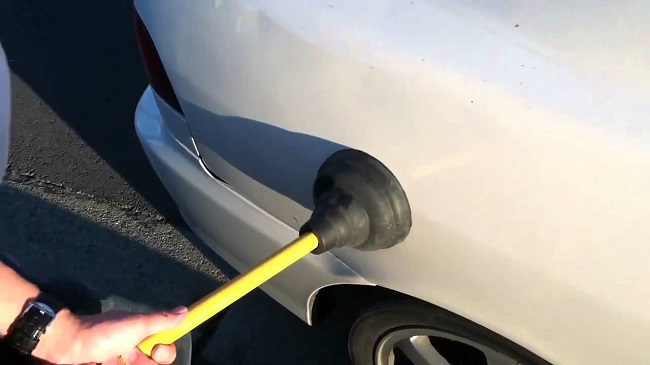 Use the Plunger to repair car dent