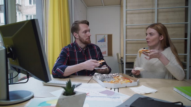 Eating pizza together