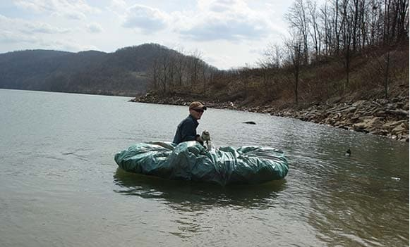 Navigate the waters using a tarp raft