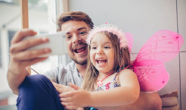 Father taking selfie with daughter