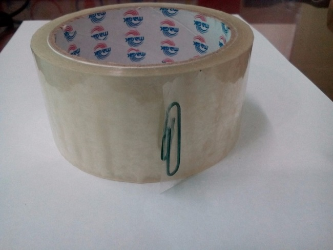Stick a paper clip at the end of tape rolls.
