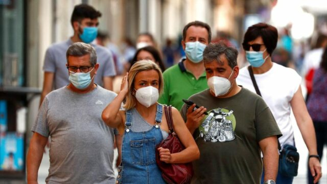 Why is it necessary to till wear a mask and practice social distancing in public despite being vaccinated