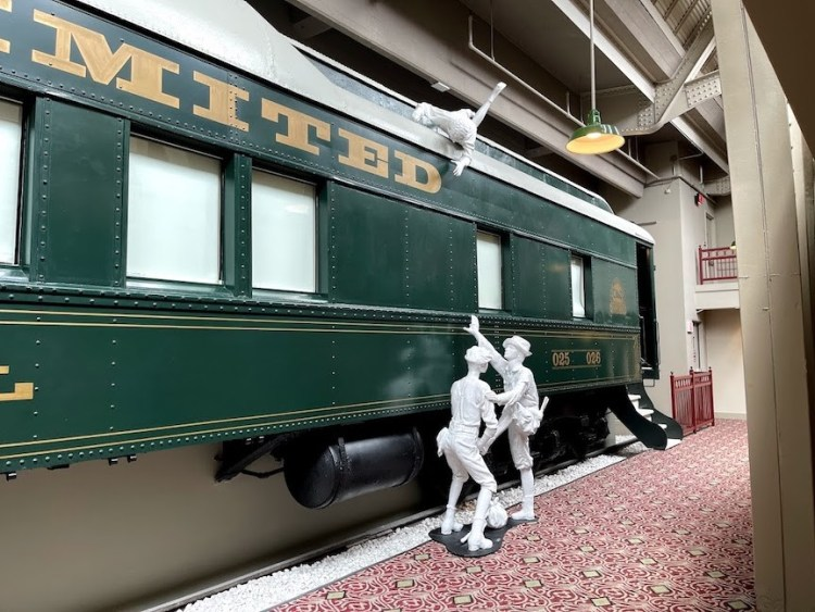 Pullman train car accommodations and some of the hotel's statues
