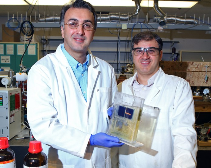 Amin Salehi-Khojin (left), UIC assistant professor of mechanical and industrial engineering, and postdoctoral researcher Mohammad Asadi with their breakthrough solar cell that converts atmospheric carbon dioxide directly into syngas.