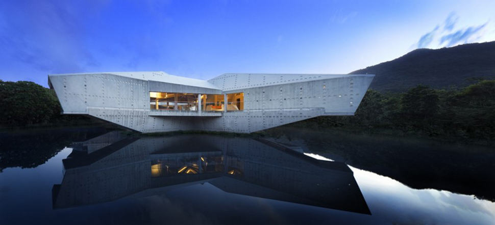 Futuristic Concrete House With Bridge Access And Eco
