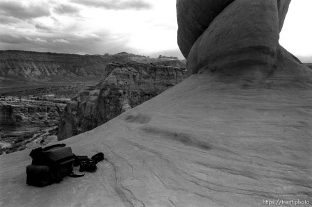Trent's gear under Delicate Arch in Arches National Park.