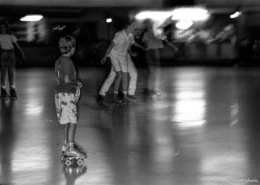 Kids roller-skating at Classic Skating Rink.