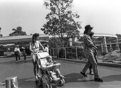 People walking by at Disneyland.