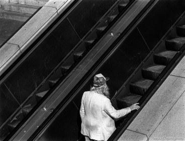 Guy on an escalator.