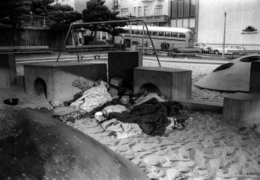 Homeless sleeping in a Chinatown playground.